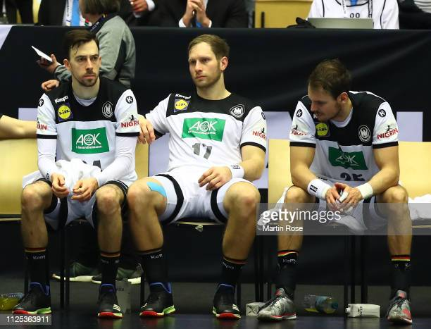 Patrick Groetzki, Steffen Weinhold and Kai Hafner of Germany look dejected after the 26th IHF Men's World Championship 3rd place match between...