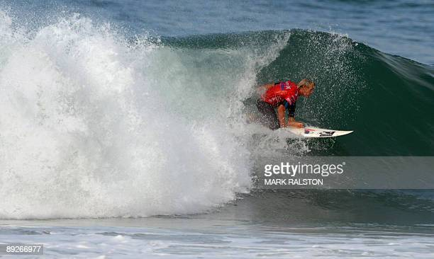 Patrick Gudauskas of the US comes out of a tube in his quarterfinal at the US Open of Surfing at Huntington Beach in Orange County California on July...