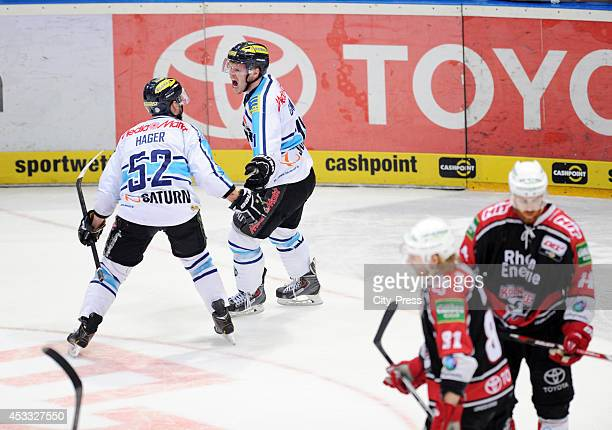 Patrick Hager and Christoph Gawlik celebrate the 0:1 during game seven of the DEL playoff final on April 29, 2014 in Cologne, Germany.