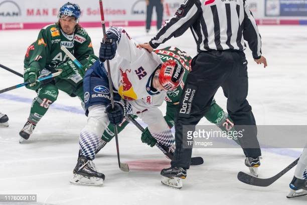 Patrick Hager of EHC Red Bull Muenchen and David Stieler of Augsburger Panther battle for the ball during the DEL match between Augsburger Panther...