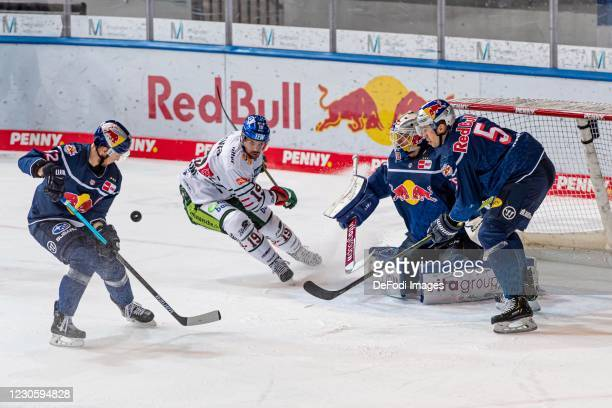 Patrick Hager of EHC Red Bull Muenchen, Andrew LeBlanc of Augsburger Panther, goalkeeper Daniel Fiessinger of EHC Red Bull Muenchen and Keith Aulie...