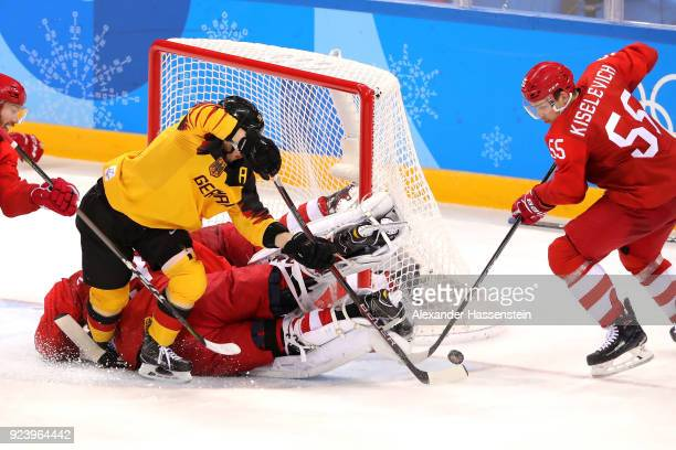 Patrick Hager of Germany attempts a shot against Vasili Koshechkin and Bogdan Kiselevich of Olympic Athlete from Russia in the third period during...