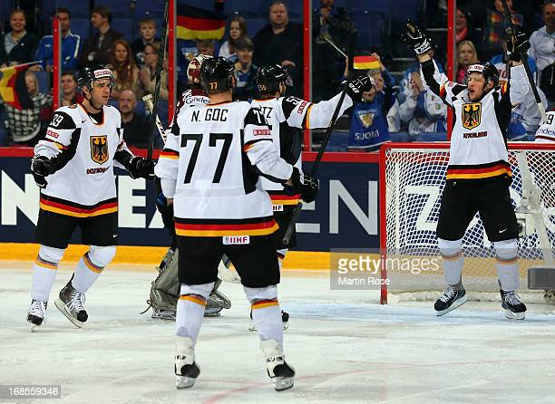 Patrick Hager of Germany celebrate with his team mates after he scores his team's 2nd goal during the IIHF World Championship group H match between...