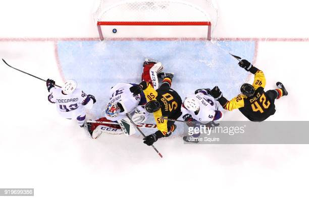 Patrick Hager of Germany celebrates after scoring a goal in the second period against Lars Haugen of Norway during the Men's Ice Hockey Preliminary...