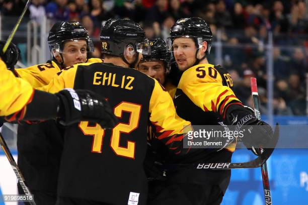 Patrick Hager of Germany celebrates with teammates after scoring a goal in the second period against Norway during the Men's Ice Hockey Preliminary...