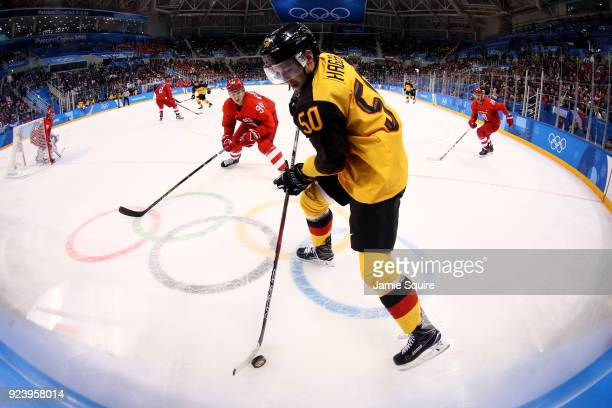 Patrick Hager of Germany controls the puck in the second period against Alexander Barabanov of Olympic Athletes from Russia during the Men's Gold...