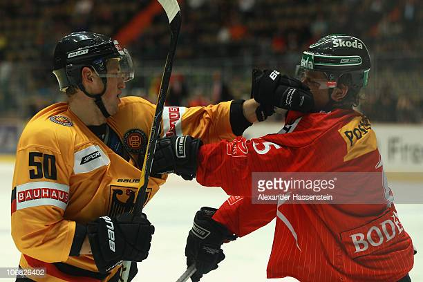 Patrick Hager of Germany fights with Simon Bodenmann of Switzerland during the German Ice Hockey Cup 2010 third round game between Germany and...