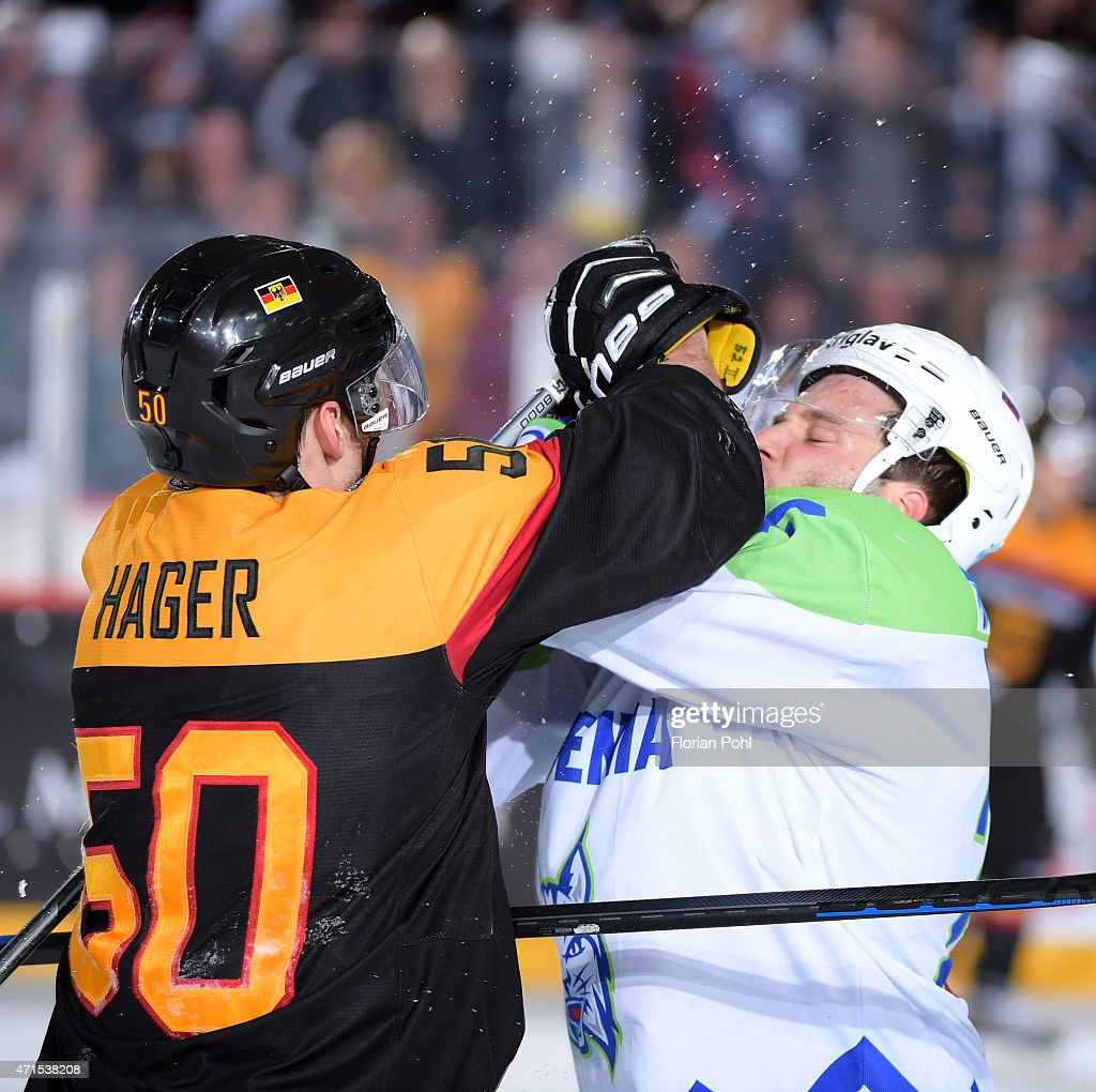 Patrick Hager of Team Germany and Rok Ticar of Team Slovenia during the game between Germany and Slovenia on april 29, 2015 in Berlin, Germany.