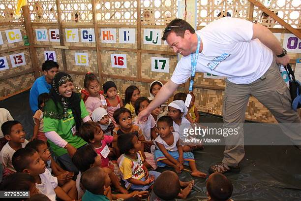 Patrick Halton of England UNICEF Philippines Child Protection specialist is seen with children affected by the fighting between Philippine security...