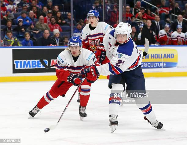 Patrick Harper of United States takes a shot as Albert Michnac of Czech Republic defends in the first period during the Bronze Medal Game of the IIHF...