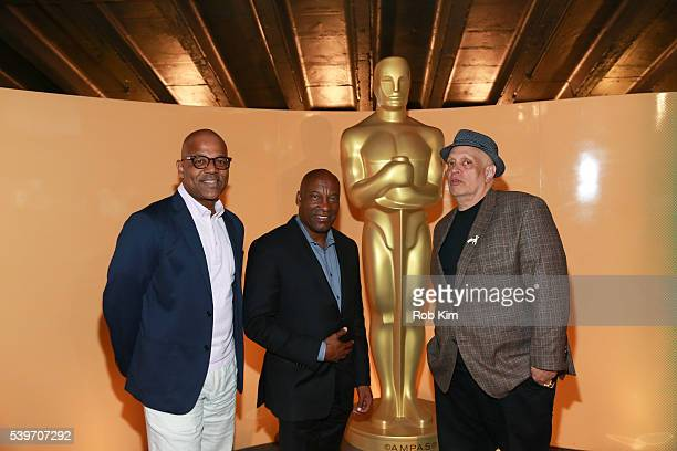 Patrick Harrison Director of New York Programs Academy Of Motion Picture Arts film director John Singleton and novelist Walter Mosley attend the...