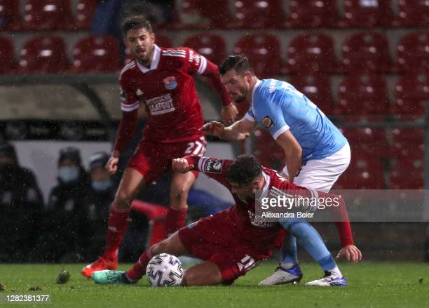Patrick Hasenhuettl of SpVgg Unterhaching fights for the ball with Quirin Moll of TSV 1860 Muenchen during the 3. Liga match between SpVgg...