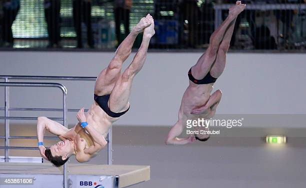 Patrick Hausding and Sascha Klein of Germany compete in the 10m men's synchronised platform final during day 8 of the 32nd LEN European Swimming...