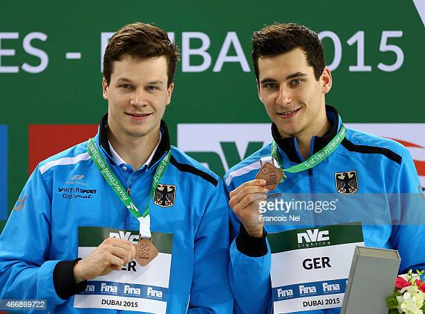 Patrick Hausding and Stephan Feck of Germany pose with their medals after the Men's 3m Synchro Springboard Final during day one of the FINA/NVC...