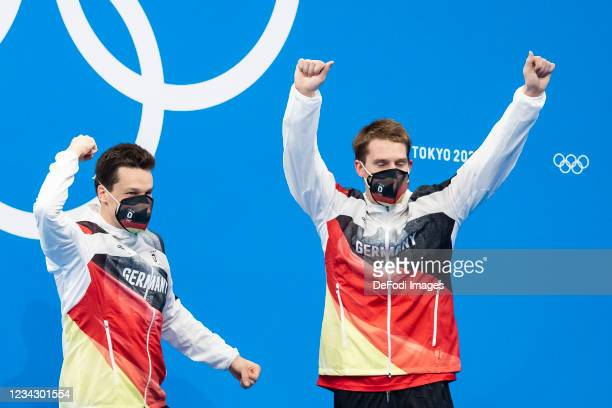 Patrick Hausding of Germany and Lars Ruediger of Germany cheering at the award ceremony during the Men's Synchronised 3m Springboard Final on day...