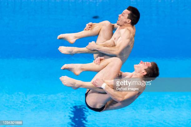 Patrick Hausding of Germany and Lars Ruediger of Germany compete during the Men's Synchronised 3m Springboard Final on day five of the Tokyo 2020...