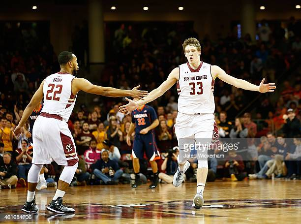 Patrick Heckmann of the Boston College Eagles celebrates a shot in the second half with teammate Maleek Frazier against the Virginia Cavaliers during...