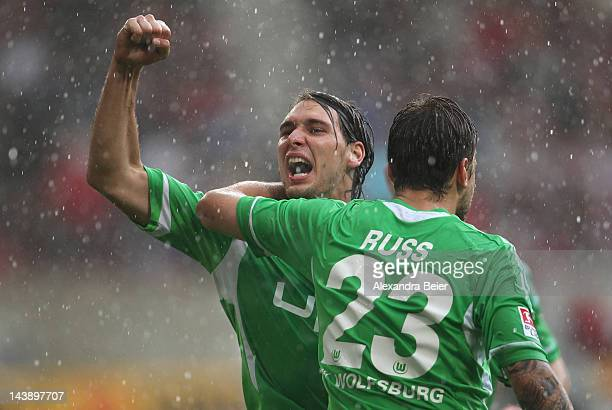 Patrick Helmes and Marco Russ of Wolfsburg celebrate their second goal during the Bundesliga match between VfB Stuttgart and VfL Wolfsburg at...