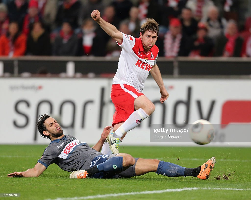 Patrick Helmes of Cologne (R) and Mergim Mavraj of Fuerth fight for the ball during the 2nd Bundesliga match between 1. FC Koeln and Greuther Fuerth at RheinEnergieStadion on February 24, 2014 in Cologne, Germany.