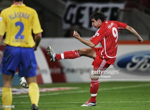 Patrick Helmes of Cologne scores the first goal during the Second Bundesliga match between 1.FC Cologne and Rot Weiss Essen at the RheinEnergie...