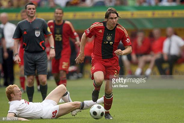 Patrick Helmes of Germany runs with the ball during the international friendly match between Germany and Belarus at the FritzWalter stadium on May 27...