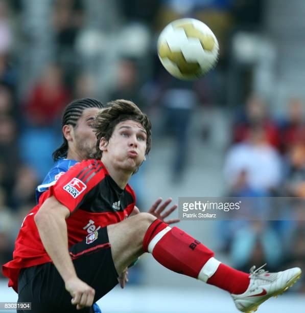 Patrick Helmes of Leverkusen battles for the ball with Yahia Anthar of Bochum during the Bundesliga match between VfL Bochum and Bayer Leverkusen at...