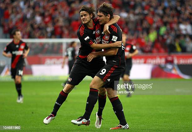 Patrick Helmes of Leverkusen celebrates with team mate Tranquillo Barnetta after scoring the first goal during the Bundesliga match between Bayer...