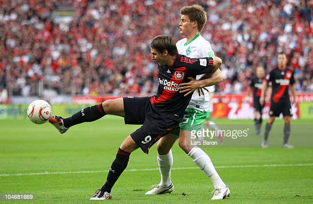 Patrick Helmes of Leverkusen is challenged by Sebastian Proedl of Bremen during the Bundesliga match between Bayer Leverkusen and Werder Bremen at...