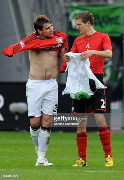 Patrick Helmes of Wolfsburg and Daniel Schwaab of Leverkusen swap jerseys after the Bundesliga match between Bayer 04 Leverkusen and VfL Wolfsburg at...