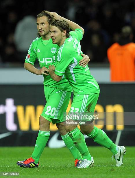 Patrick Helmes of Wolfsburg jubilates with team mate Petr Jiracek after scoring the fifth goal during the Bundesliga match between Hertha BSC Berlin...
