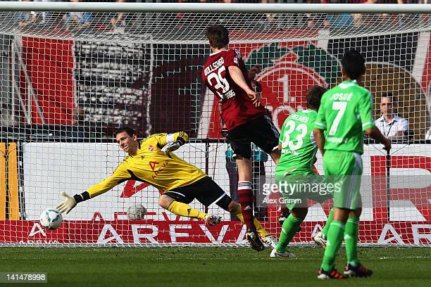 Patrick Helmes of Wolfsburg scores his team's second goal against goalkeeper Raphael Schaefer of Nuernberg during the Bundesliga match between 1 FC...