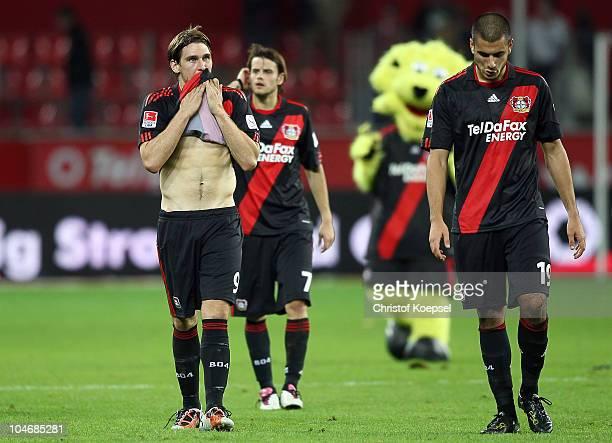 Patrick Helmes, Tranquillo Barnetta and Eren Derdiyok of Leverkusen look dejected after the 2-2 draw of the Bundesliga match between Bayer Leverkusen...