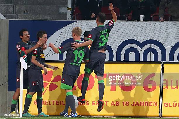 Patrick Hermann of Gladbach celebrates scoring his first team goal with his team mates during the Bundesliga match between FC Augsburg and VfL...