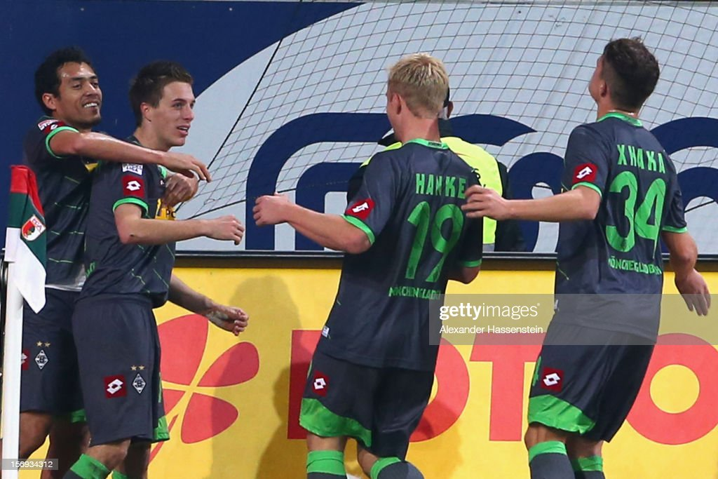 Patrick Hermann (2nd L) of Gladbach celebrates scoring his first team goal with his team mates during the Bundesliga match between FC Augsburg and VfL Borussia Moenchengladbach at SGL Arena on November 25, 2012 in Augsburg, Germany.
