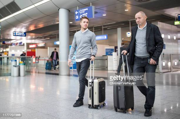 Patrick Herrmann and Assistant Coach Oliver Neuville seen during Borussia Moenchengladbach departs to Rome at Duesseldorf Airport on October 23 2019...