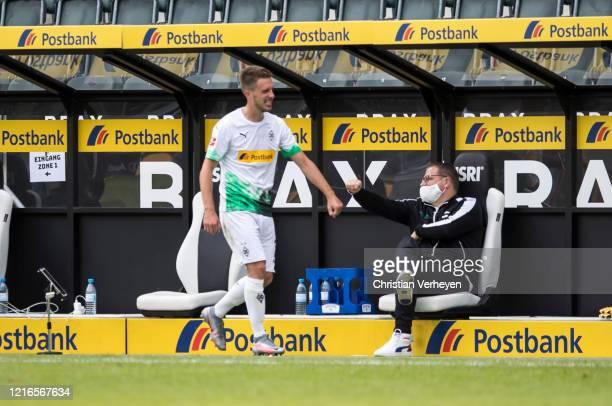 Patrick Herrmann and Director of Sport Max Eberl of Borussia Moenchengladbach are seen during the Bundesliga match between Borussia Moenchengladbach...
