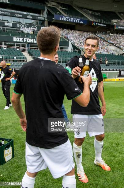 MOENCHENGLADBACH GERMANY JUNE Patrick Herrmann and Florian Neuhaus of Borussia Moenchengladbach celebrate after the Bundesliga match between Borussia...