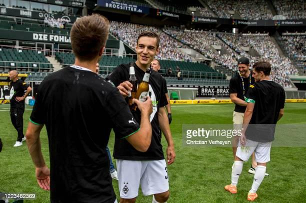 Patrick Herrmann and Florian Neuhaus of Borussia Moenchengladbach celebrate after the Bundesliga match between Borussia Moenchengladbach and Hertha...
