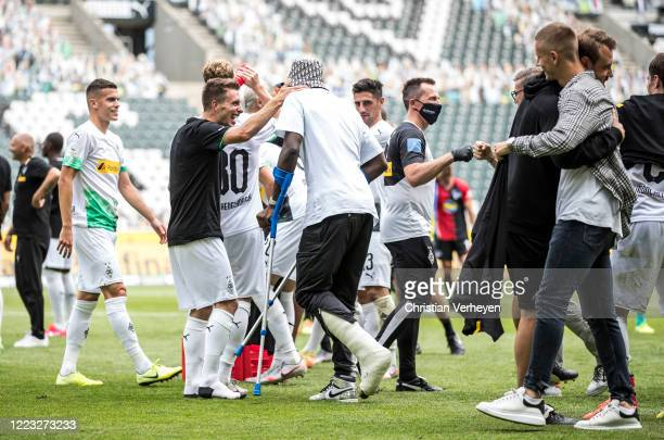 MOENCHENGLADBACH GERMANY JUNE Patrick Herrmann and Marcus Thuram of Borussia Moenchengladbach celebrate their Teams win and the Qualification for the...