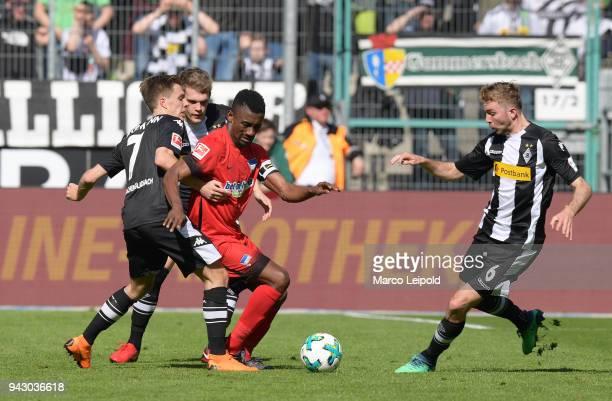Patrick Herrmann Matthias Ginter of Borussia Moenchengladbach Salomon Kalou of Hertha BSC and Christoph Kramer of Borussia Moenchengladbach during...