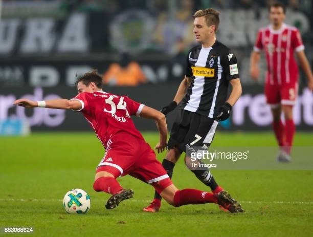 Patrick Herrmann of Borussia Moenchengladbach and Marco Friedl of Bayern Muenchen battle for the ball during the Bundesliga match between Borussia...