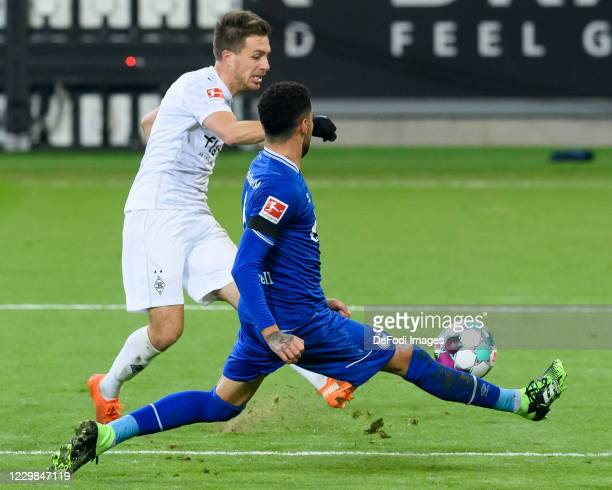 Patrick Herrmann of Borussia Moenchengladbach and Omar Mascarell of FC Schalke 04 battle for the ball during the Bundesliga match between Borussia...