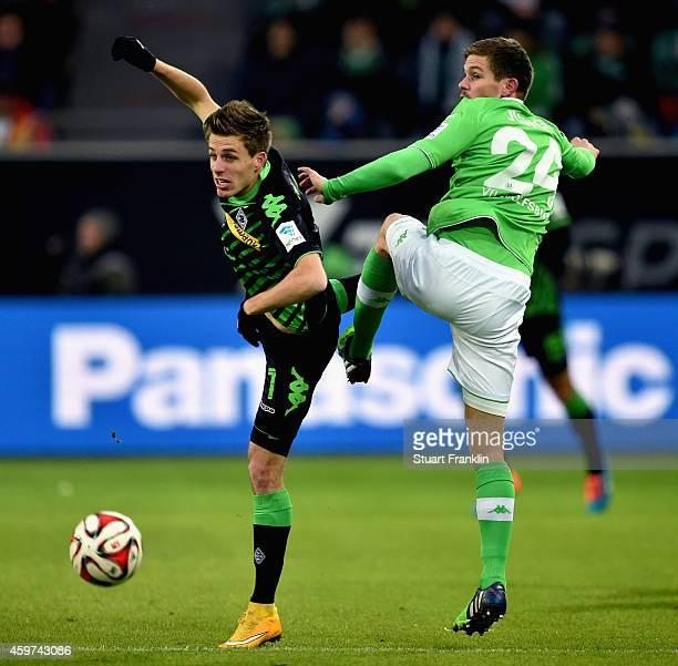 Patrick Herrmann of Borussia Moenchengladbach and Sebastian Jung of VfL Wolfsburg battle for the ball during the Bundesliga match between VfL...
