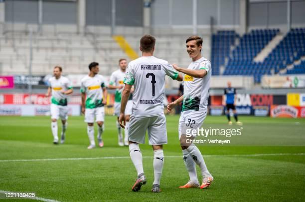 Patrick Herrmann of Borussia Moenchengladbach celebrates with team mate Florian Neuhaus after he scores his teams first goal during the Bundesliga...