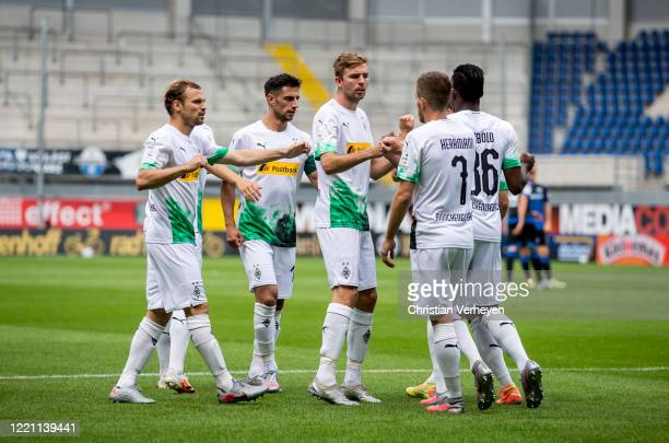 Patrick Herrmann of Borussia Moenchengladbach celebrates with team mates after he scores his teams first goal during the Bundesliga match between SC...