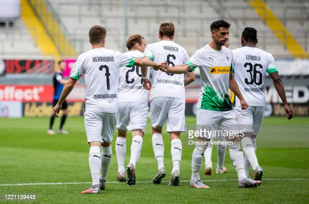 Patrick Herrmann of Borussia Moenchengladbach celebrates with team mate Lars Stindl after he scores his teams first goal during the Bundesliga match...