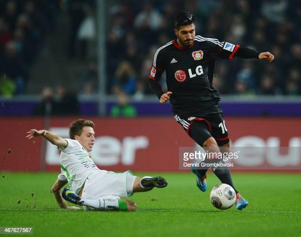 PAtrick Herrmann of Borussia Moenchengladbach challenges Emre Can of Bayer Leverkusen during the Bundesliga match between Borussia Moenchengladbach...