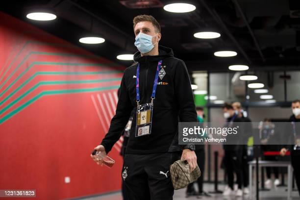 Patrick Herrmann of Borussia Moenchengladbach enters the stadium before the UEFA Champions League Round Of 16 Leg One match between Borussia...