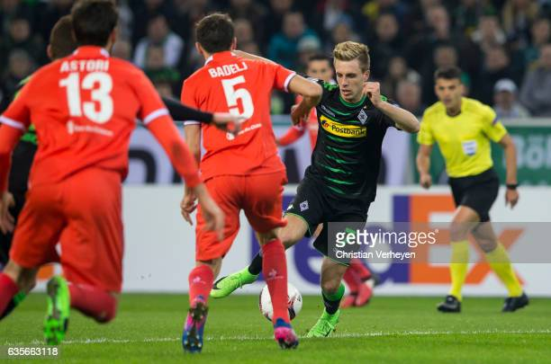 Patrick Herrmann of Borussia Moenchengladbach Milan Badelj and Davide Astori of ACF Fiorentina battle for the ball during the UEFA Euro League Match...