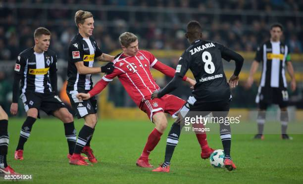 Patrick Herrmann of Borussia Moenchengladbach Robert Lewandowski of Bayern Muenchen Thorgan Hazard of Borussia Moenchengladbach and Denis Zakaria of...